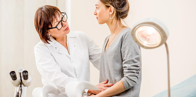 A female doctor is examining a female patient