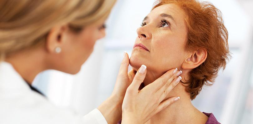 Female doctor examining her patient.