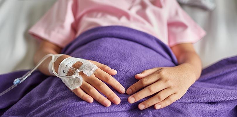Close-up of patient receiving IV Drip medicine at hospital