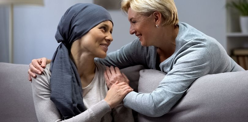 A mom talking to her daughter about colon cancer treatment.