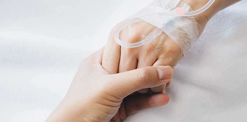 A person holding another person's hand.